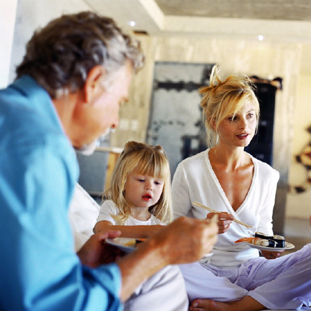 Parents and daughter eating : Stock Photo