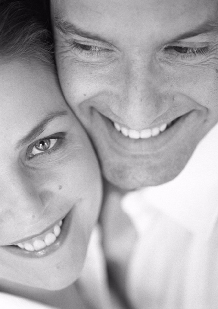 Couple cheek to cheek, close-up, b&w : Stock Photo