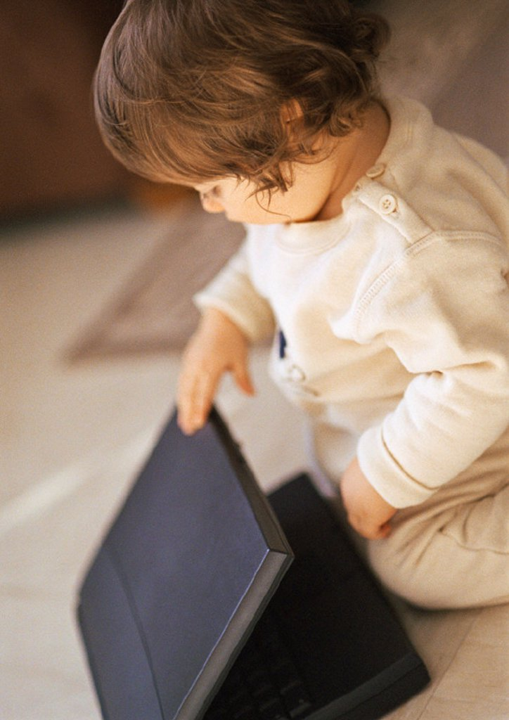 Stock Photo: 1569R-132082 Baby with laptop, portrait