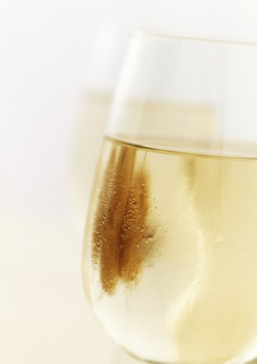 Stock Photo: 1569R-137076 Glass of white wine, close-up