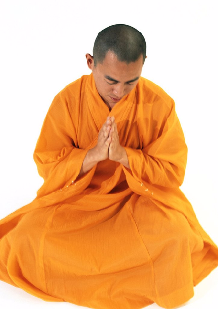 Stock Photo: 1569R-138021 Buddhist monk sitting, meditating with hands together, high angle view