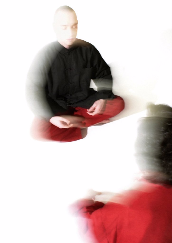 Stock Photo: 1569R-138036 People sitting on floor indian style, meditating, blurred