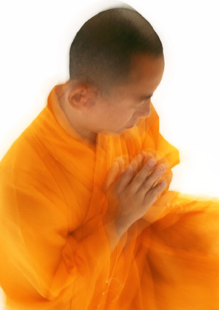 Stock Photo: 1569R-138045 Buddhist monk meditating, blurred, high angle view