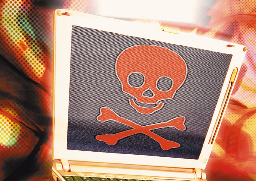 Laptop with skull and crossbones, digital composite : Stock Photo
