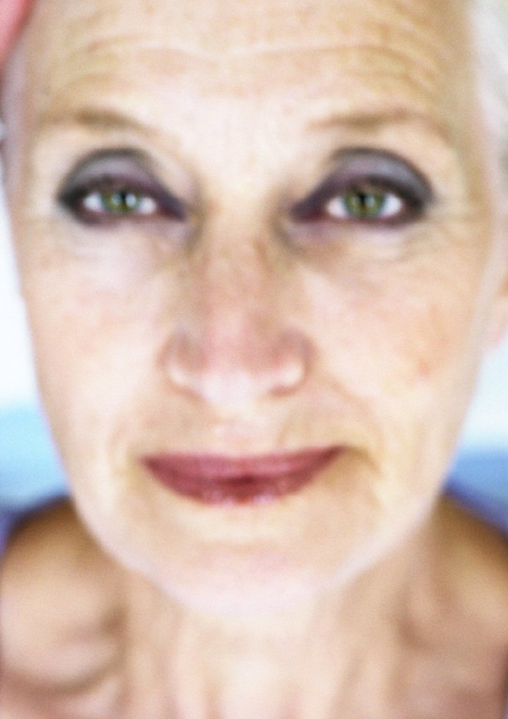 Mature woman, close-up, portrait, blurred : Stock Photo