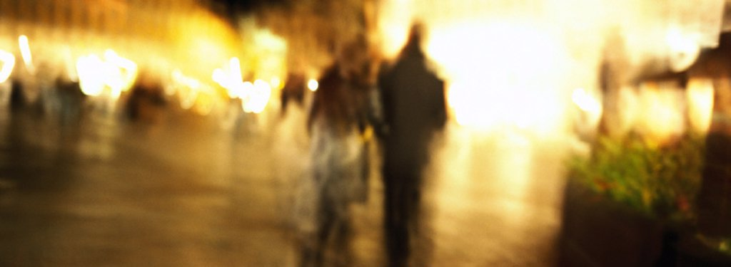 Stock Photo: 1569R-146010 Couple walking at night, blurred
