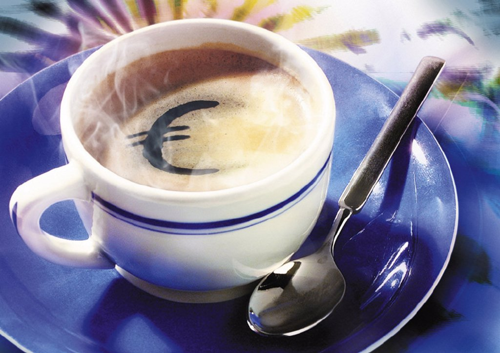 Euro sign in cup of coffee : Stock Photo