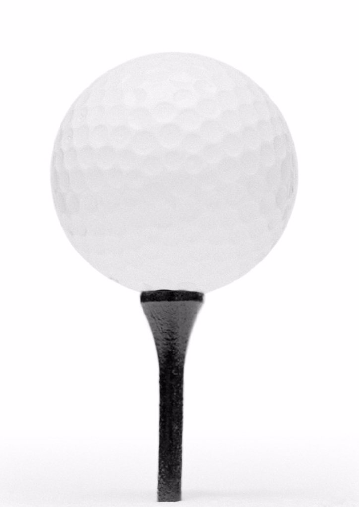 Stock Photo: 1569R-153023 Golf ball and tee, close-up, b&w