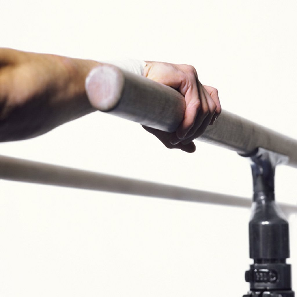 Stock Photo: 1569R-155063 Gymnast´s hand grasping parallel bar, close-up