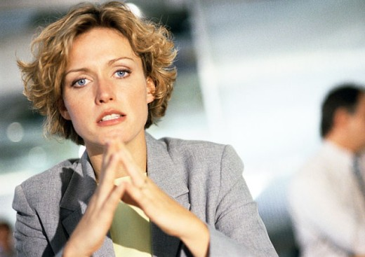 Businesswoman looking into camera, portrait : Stock Photo