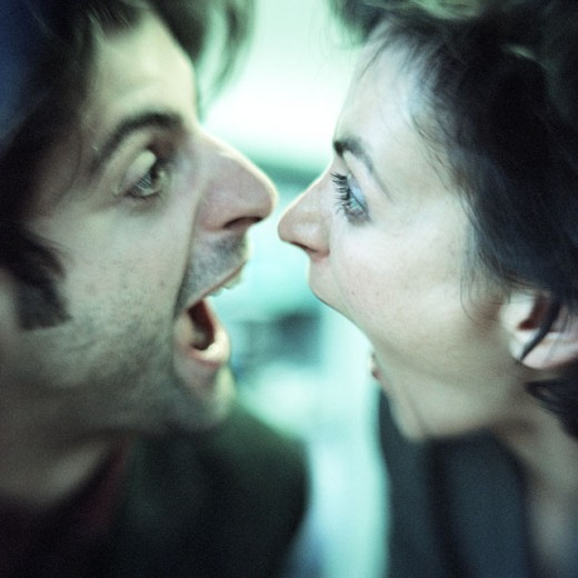 Man and woman face to face, both screaming, close-up : Stock Photo