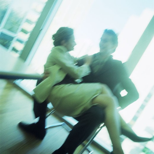 Woman sitting in man´s lap, blurred : Stock Photo
