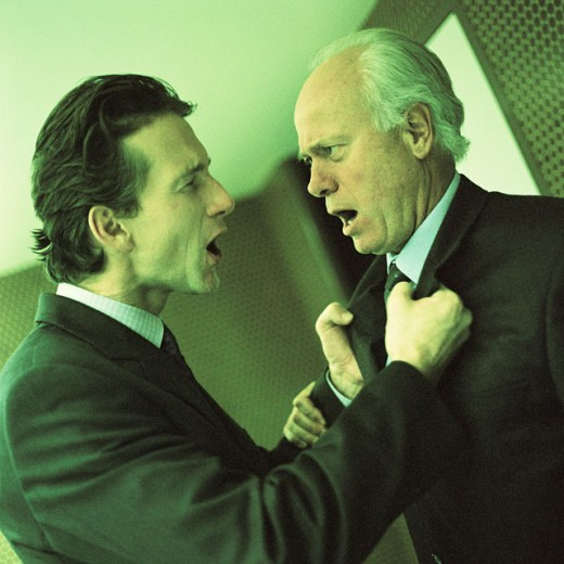 Two businessmen arguing, side view : Stock Photo