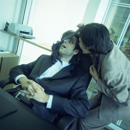 Woman waking sleeping colleague : Stock Photo