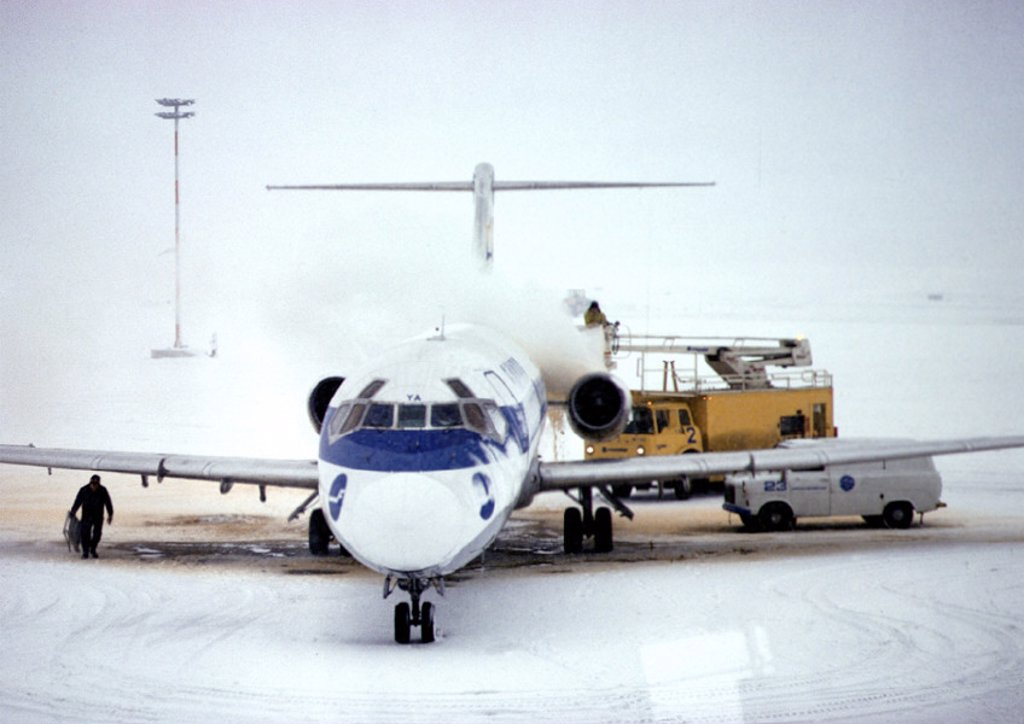 Finland, plane on snowy runway : Stock Photo