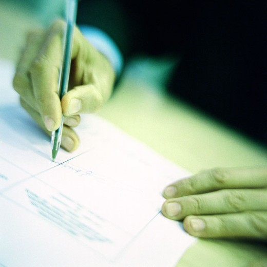 Man signing document, close up of hands : Stock Photo