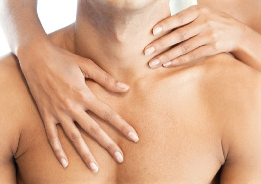 Woman´s hands massaging man´s chest and neck, close-up : Stock Photo