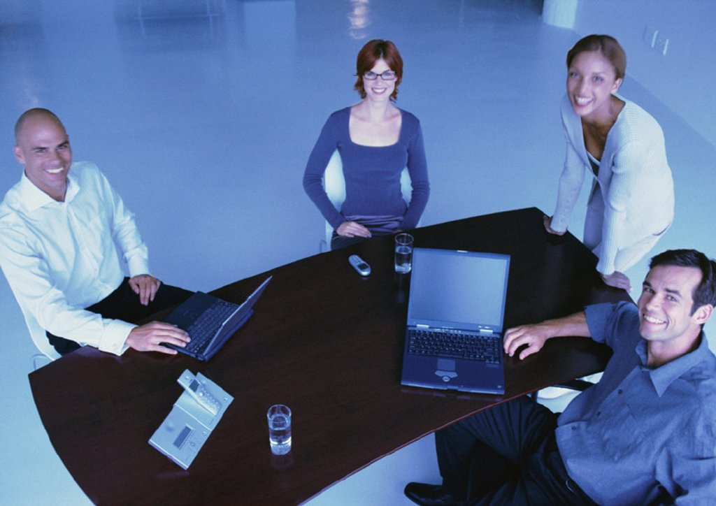 Stock Photo: 1569R-167006 Business people around desk, smiling, elevated view