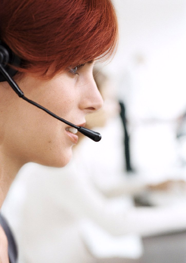 Stock Photo: 1569R-167025 Woman wearing headset, side view