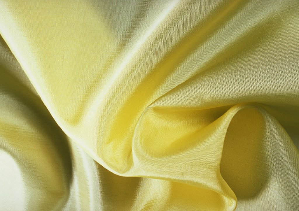 Stock Photo: 1569R-17076 Folds in yellow silk, close-up, full frame