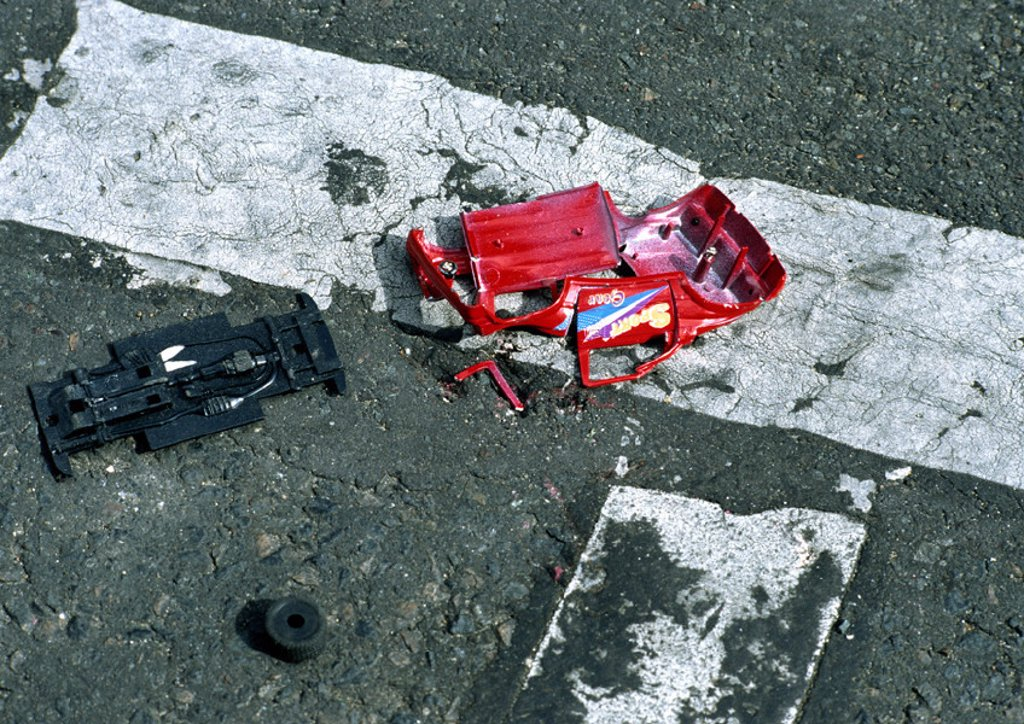 Toy car smashed in road : Stock Photo