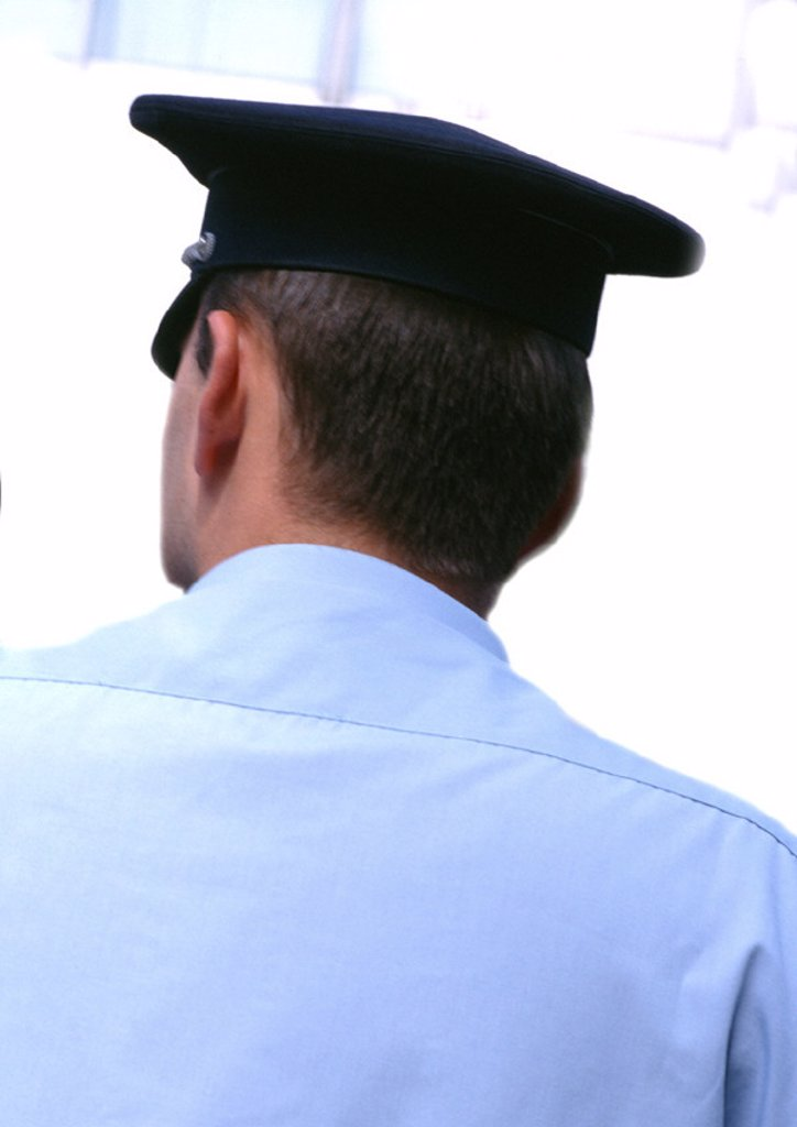 Policeman, rear view : Stock Photo