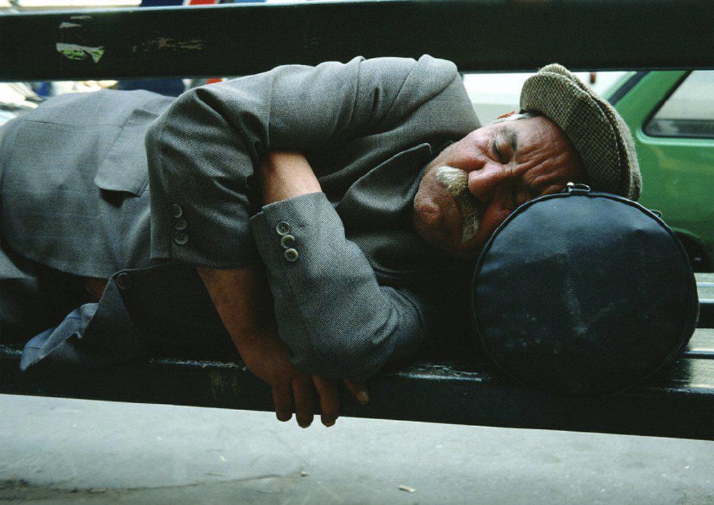 Man sleeping on park bench : Stock Photo