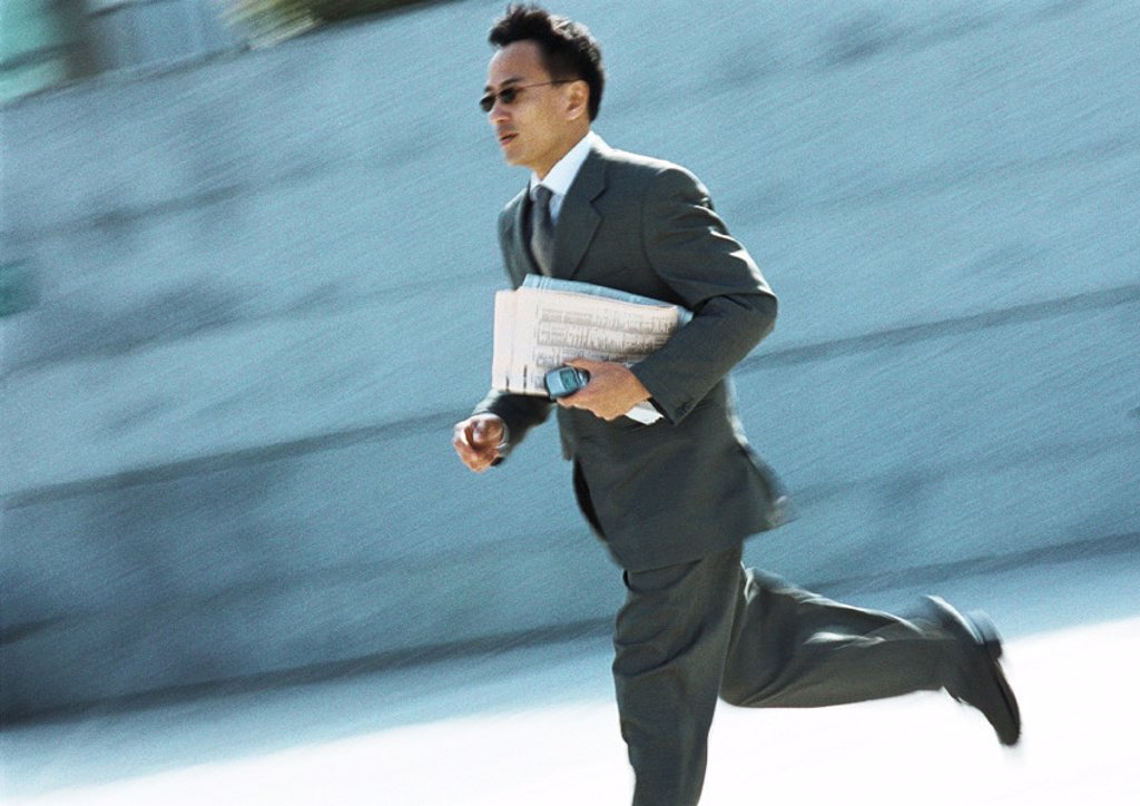 Stock Photo: 1569R-181027 Businessman running outdoors