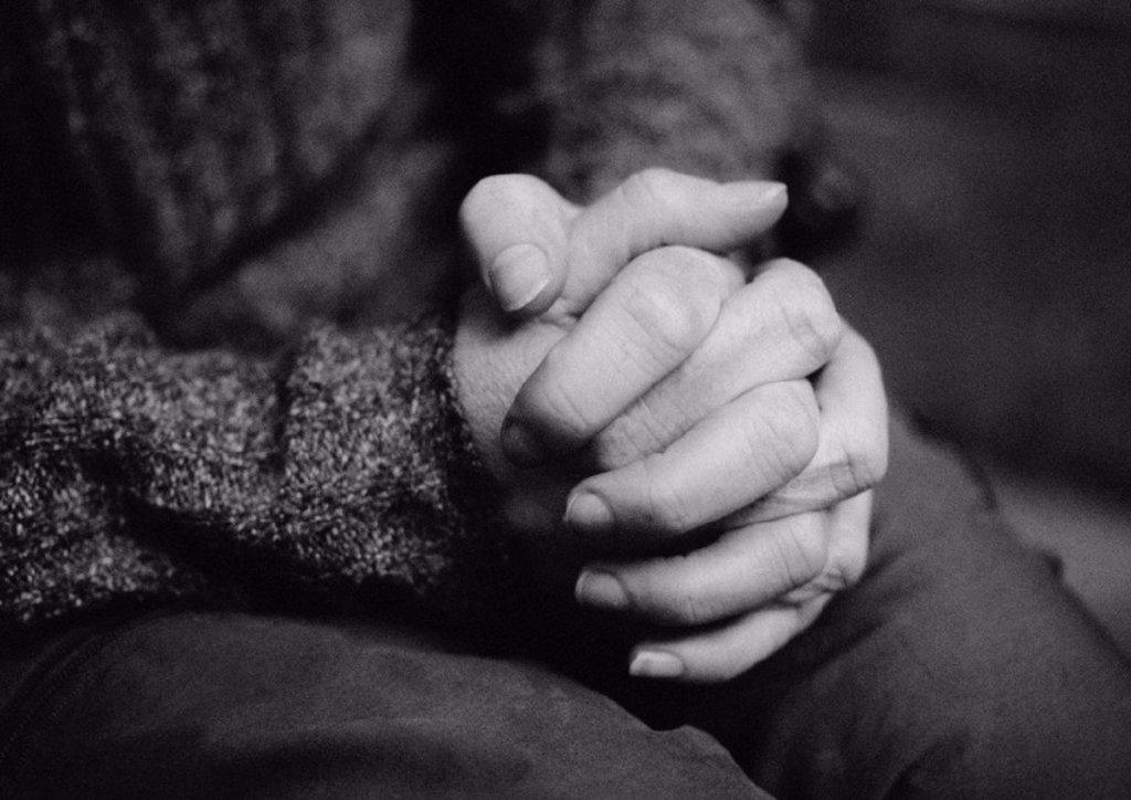 Clasped hands, close-up, b&w : Stock Photo