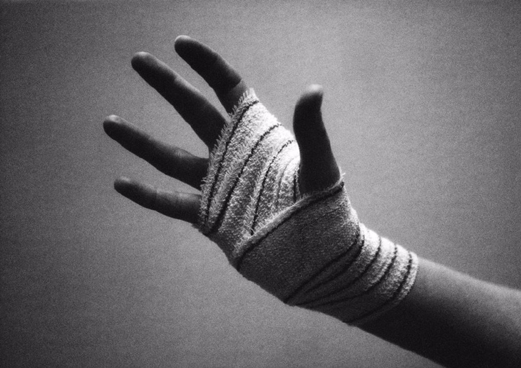 Stock Photo: 1569R-185022 Bandaged hand, close-up, b&w