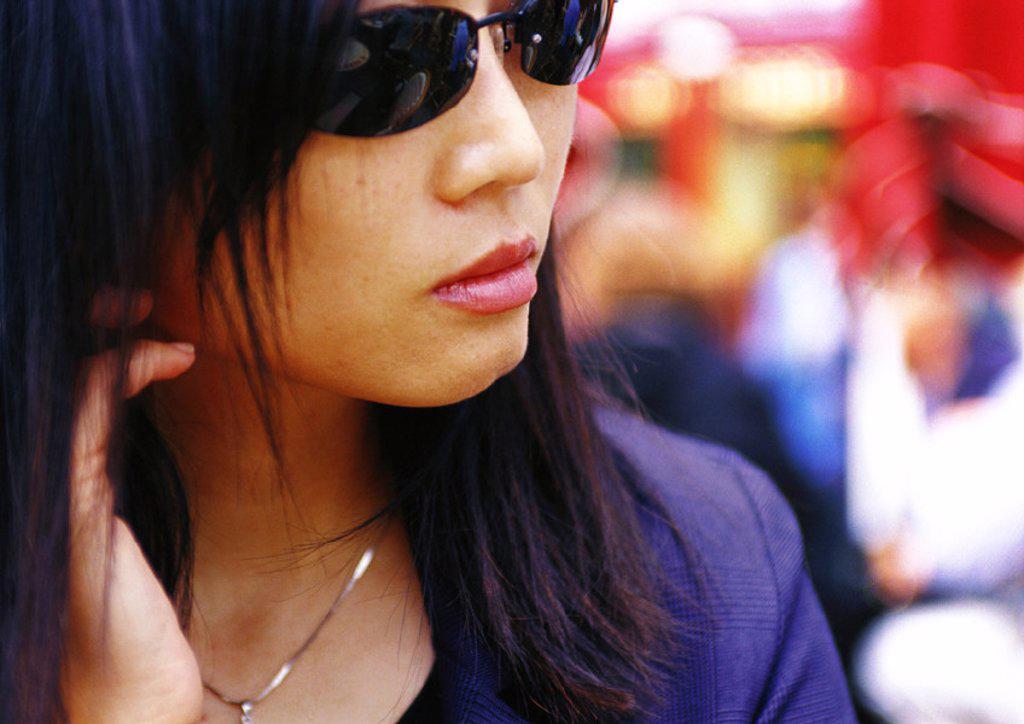 Woman wearing sunglasses, close-up : Stock Photo