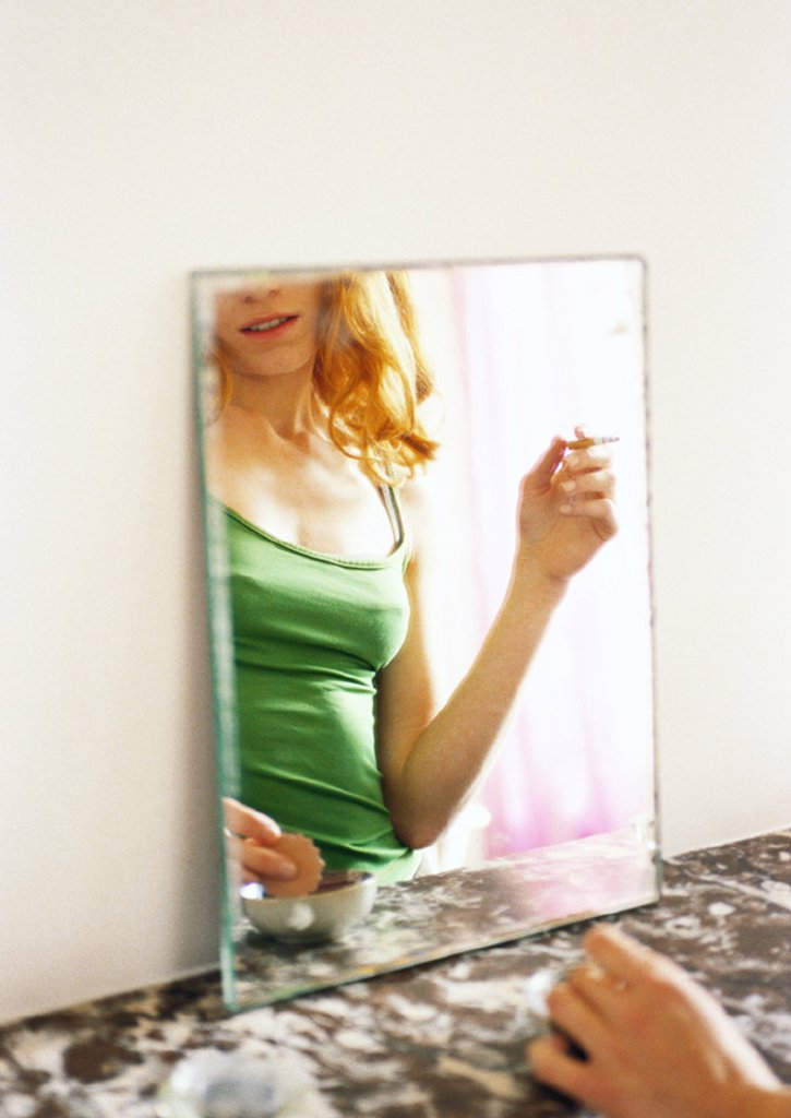 Woman´s reflection in mirror : Stock Photo