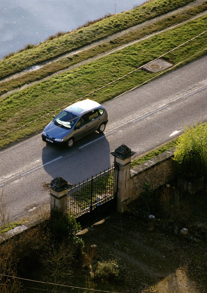 Stock Photo: 1569R-19050 Car on road next to gate, high angle view