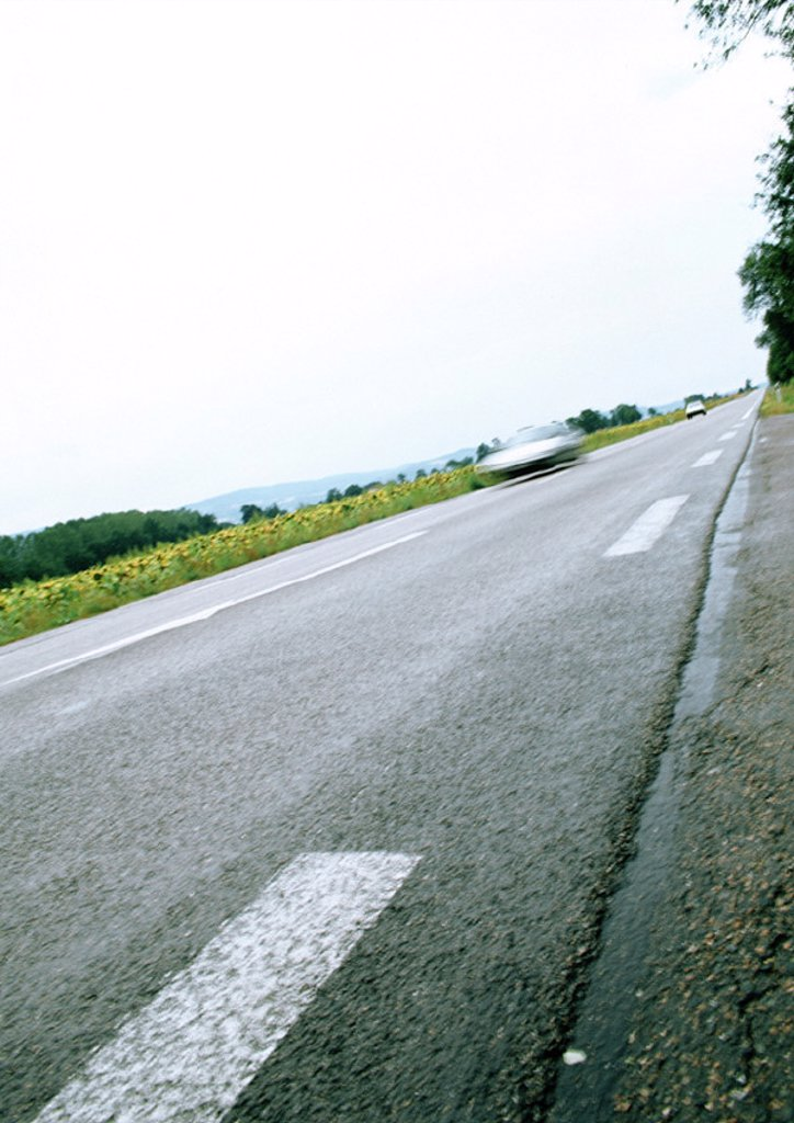 White lines on road, low angle view, tilt : Stock Photo