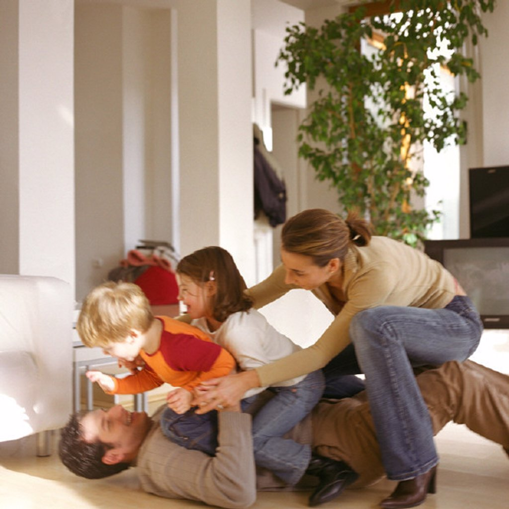 Family playing together : Stock Photo