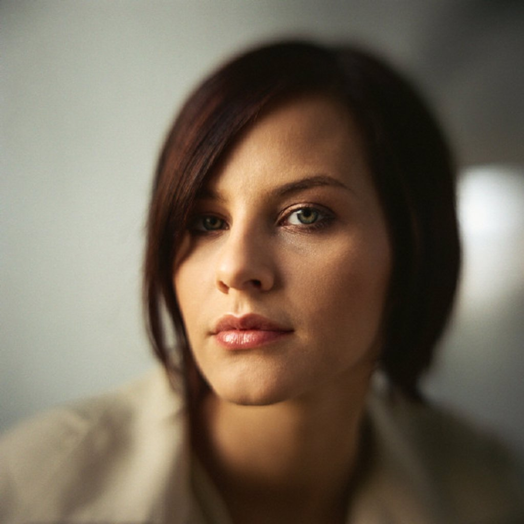 Woman looking at camera, portrait : Stock Photo