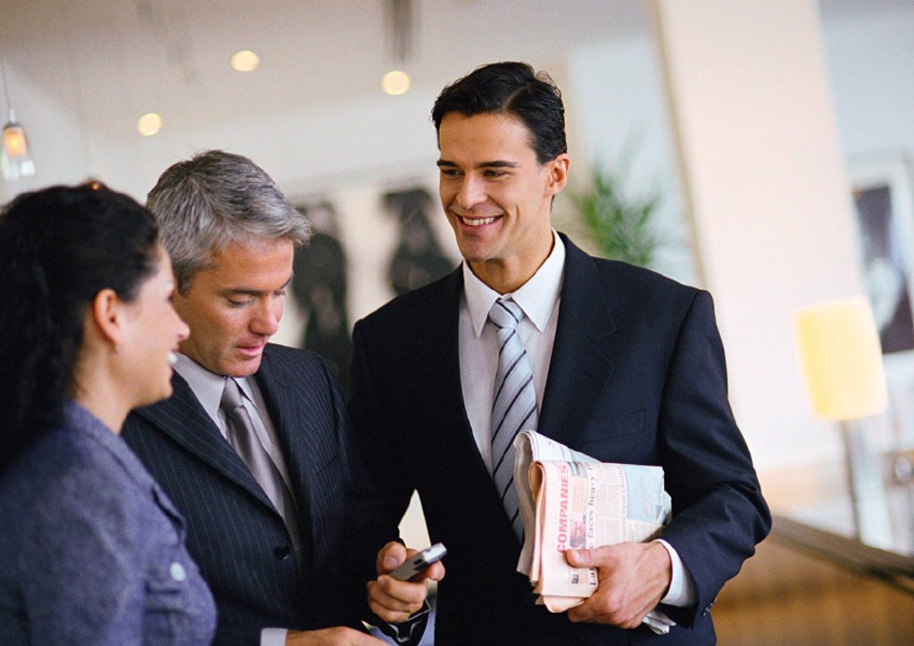Group of business people talking together, waist up : Stock Photo