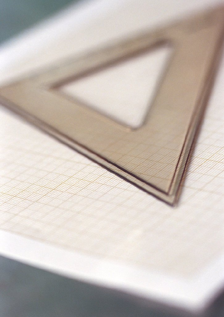 Triangle on notebook : Stock Photo