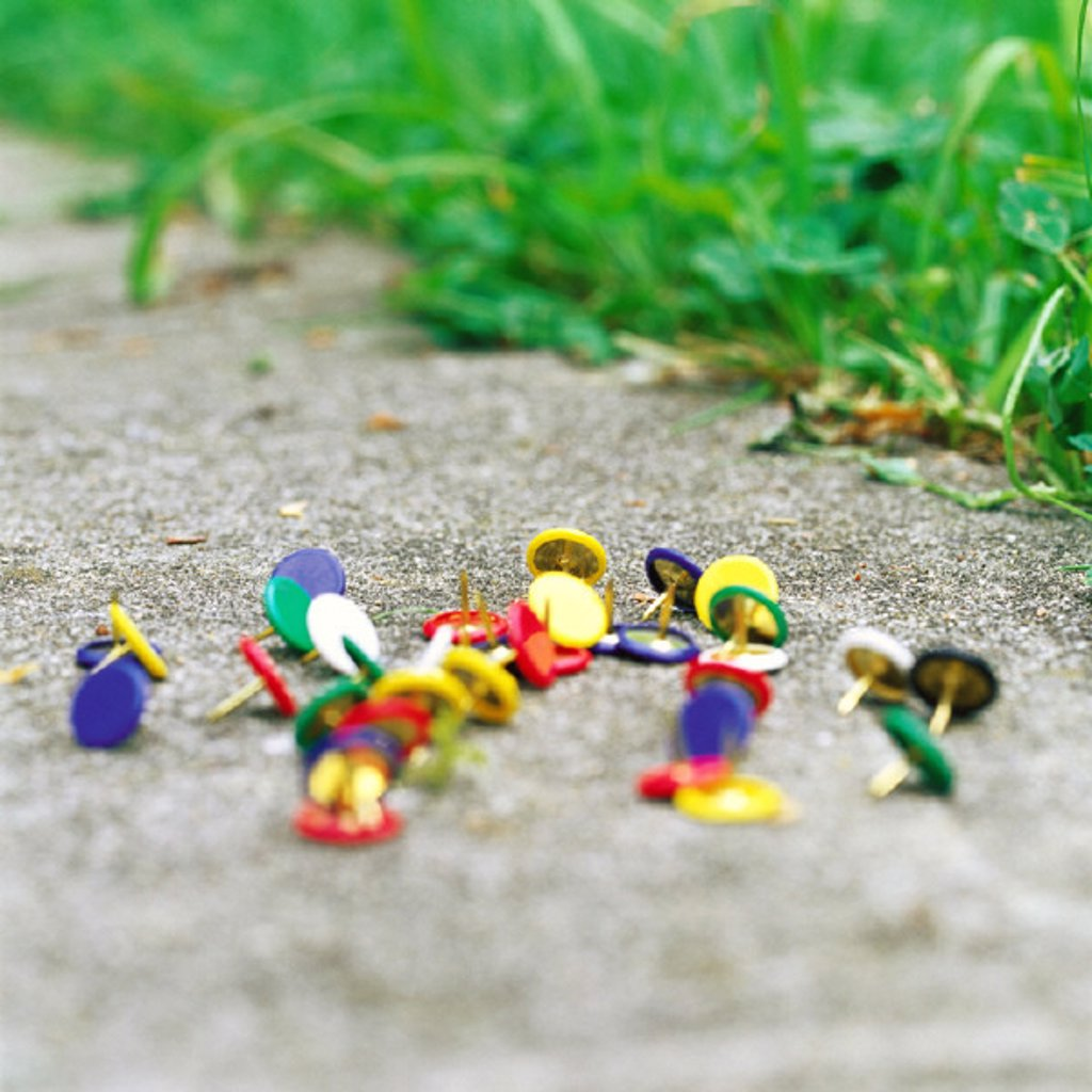Thumbtacks on ground : Stock Photo