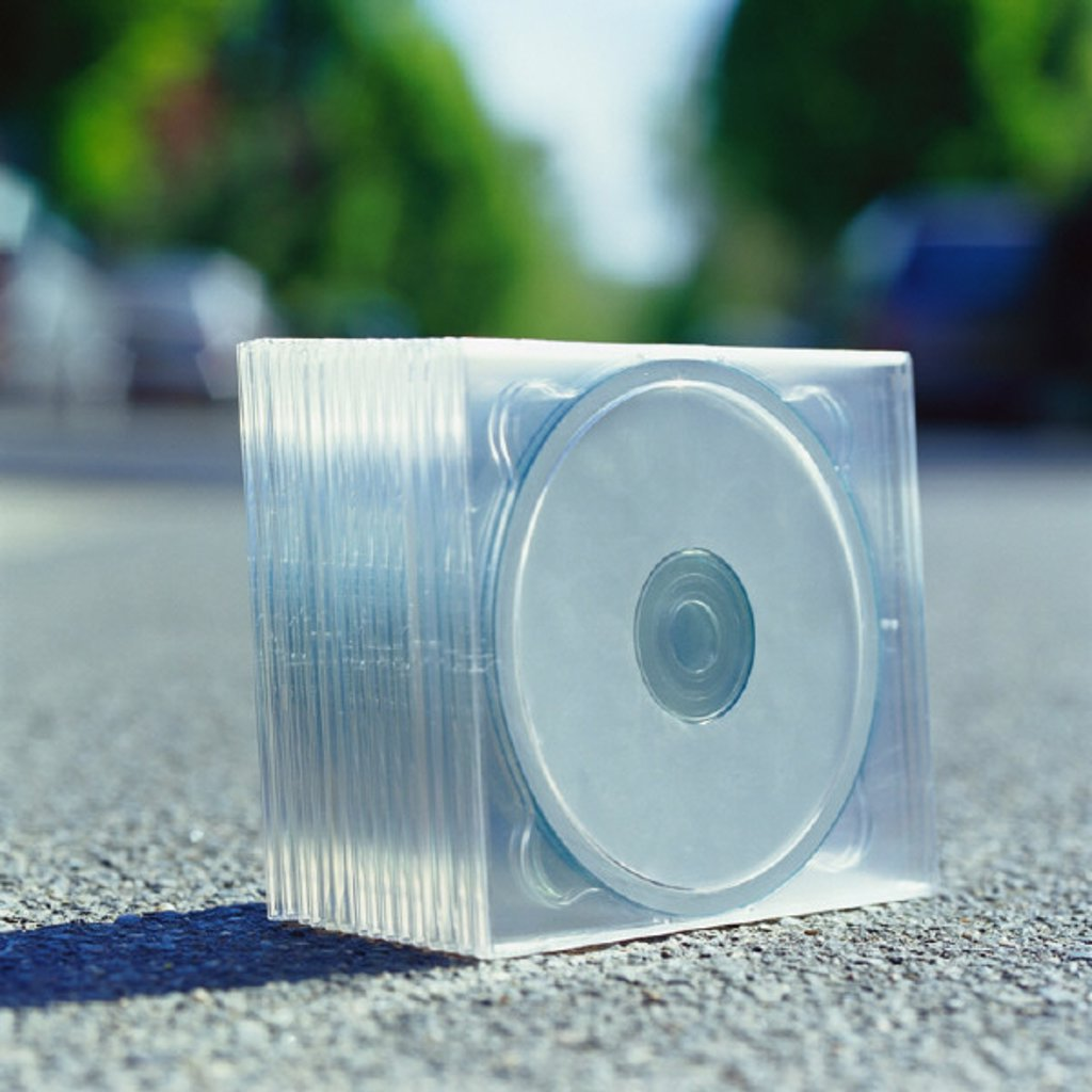 Pack of CDs on ground : Stock Photo
