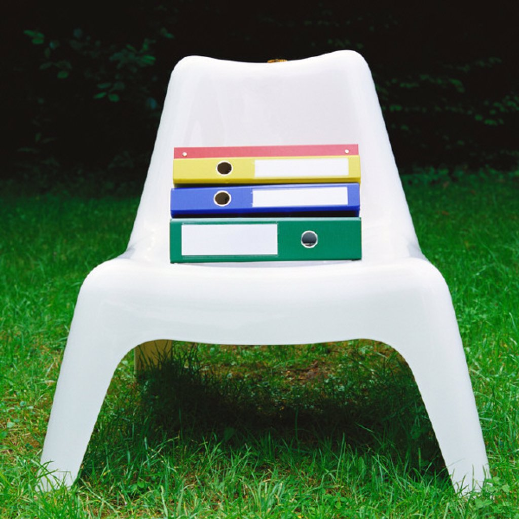 Files on plastic chair : Stock Photo