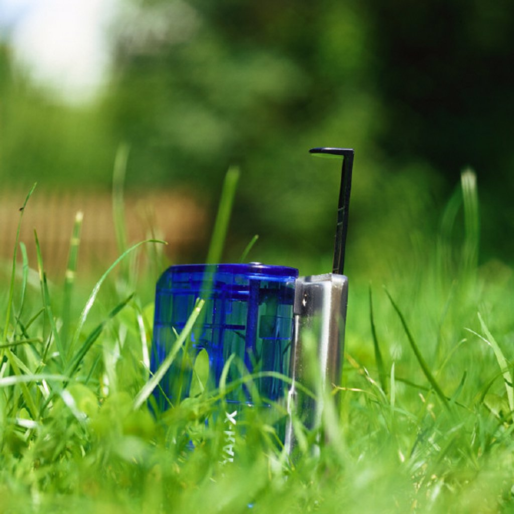 Hole puncher in grass, close-up : Stock Photo