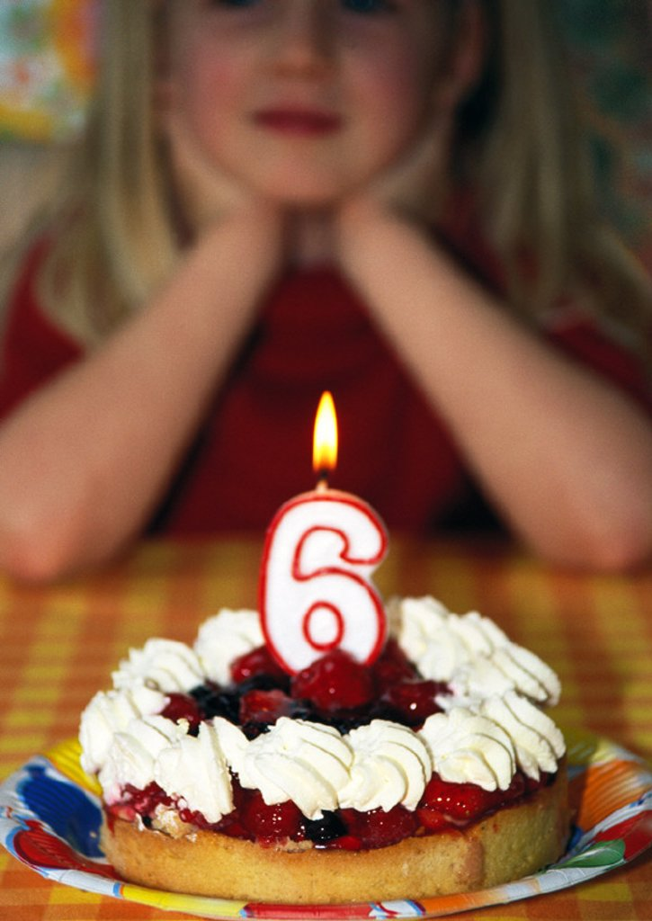 Little girl with birthday cake, portrait : Stock Photo