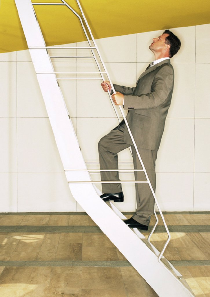 Man climbing ladder : Stock Photo