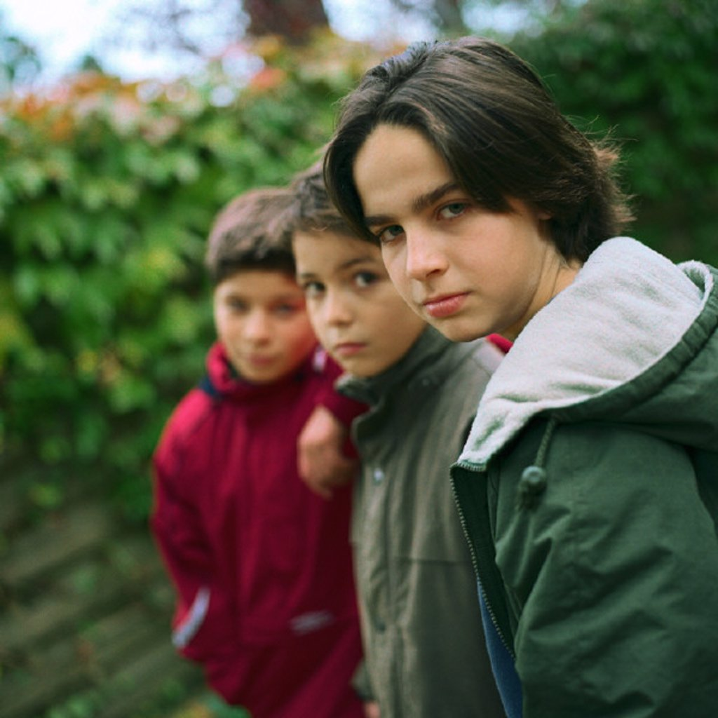 Stock Photo: 1569R-222020 Three boys looking into camera, outside