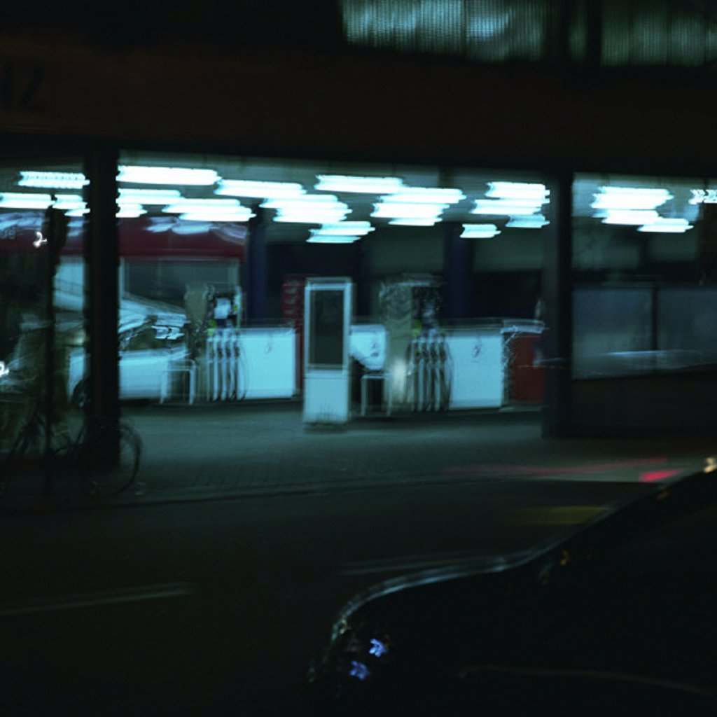 Service station at night, long exposure : Stock Photo