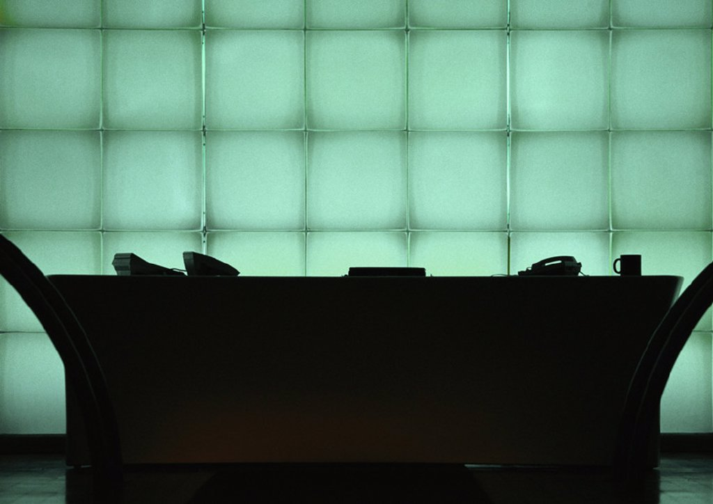 Desk in front of windows, silhouette : Stock Photo