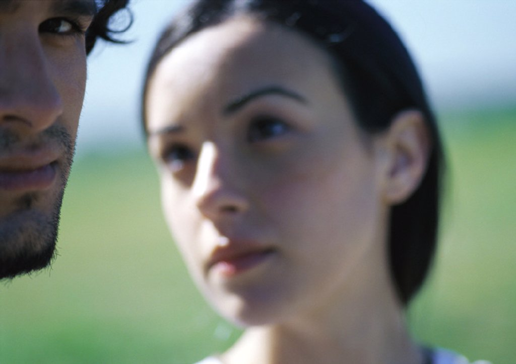 Woman looking at man, close up : Stock Photo