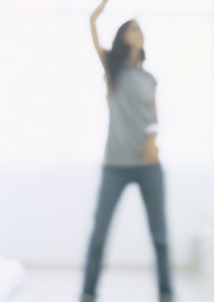 Stock Photo: 1569R-238003 Silhouette of young woman, blurred