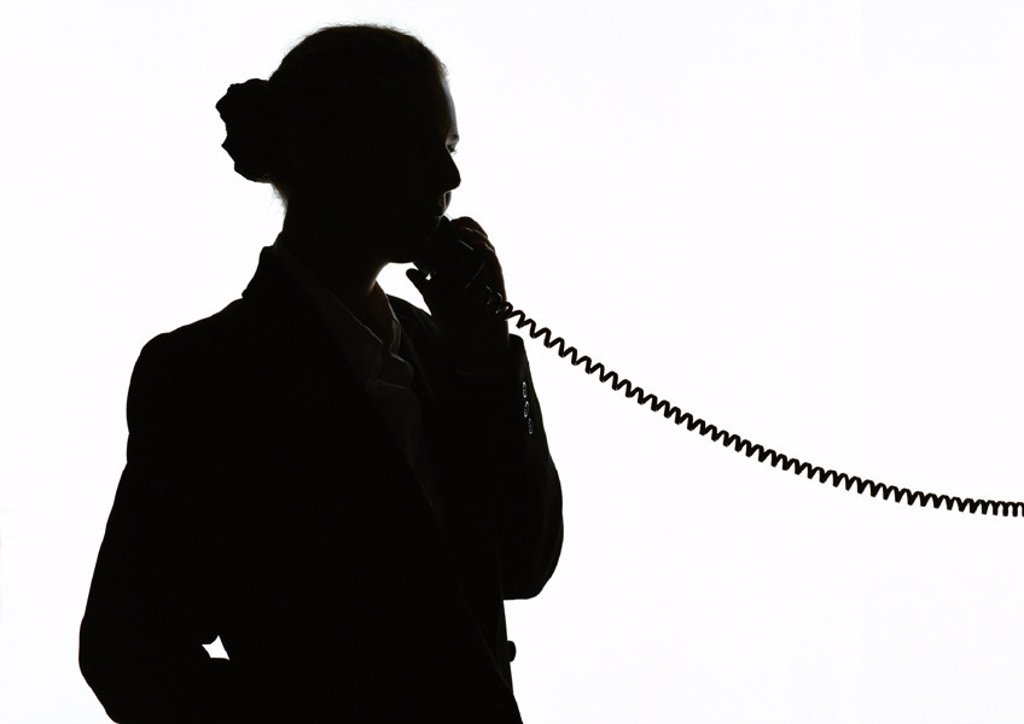 Stock Photo: 1569R-25043 Woman on phone, silhouette